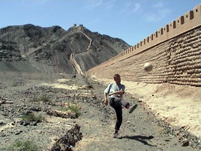 The Ball 2002 is kicked over the Great Wall of China on its way to Korea & Japan
