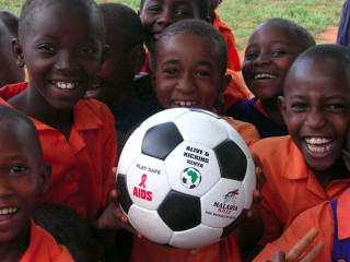 Children with an Alive & Kicking ball
