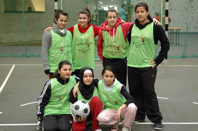 A girls team pose with The Ball