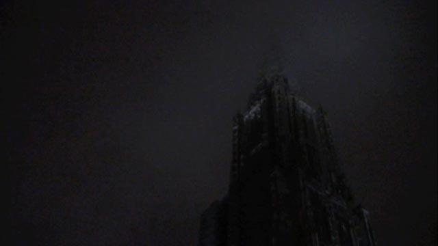 Ulm Münster spire shrouded by fog at night