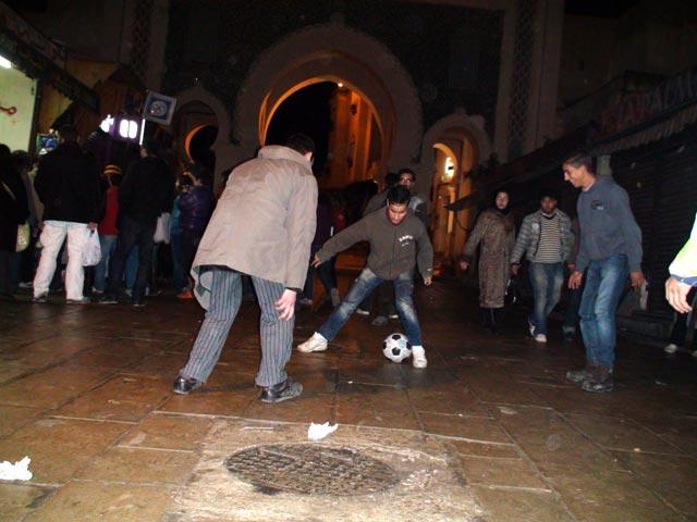 Playing football near one of the medina gates