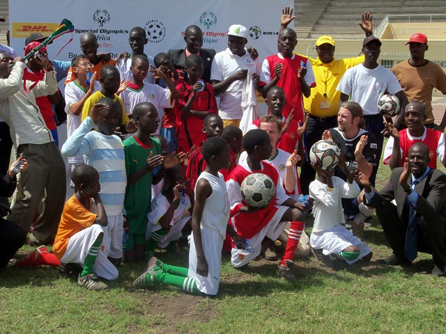 Unified Football teams pose with The Ball