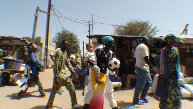 The Ball is carried through the streets of Dakar