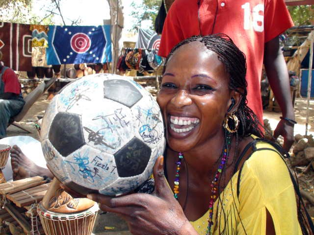 A girl smiles with The Ball