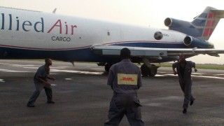 DHL staff play with The Ball on the tarmac