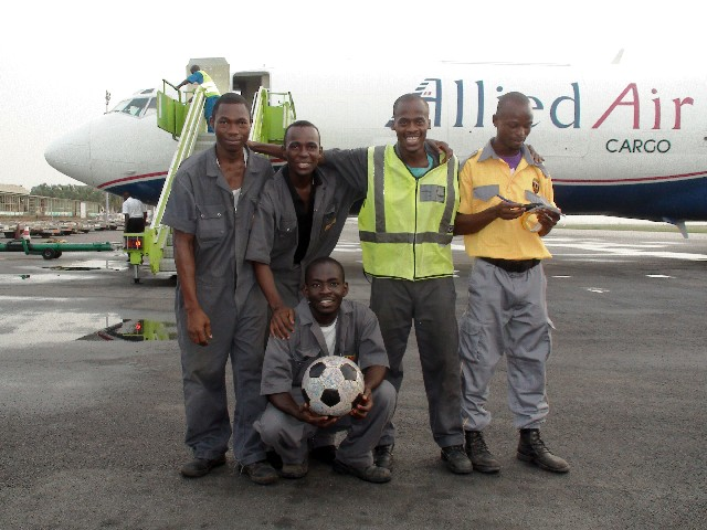 Cargo staff pose with The Ball