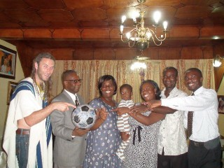 Kweku and his family embrace Andrew and The Ball