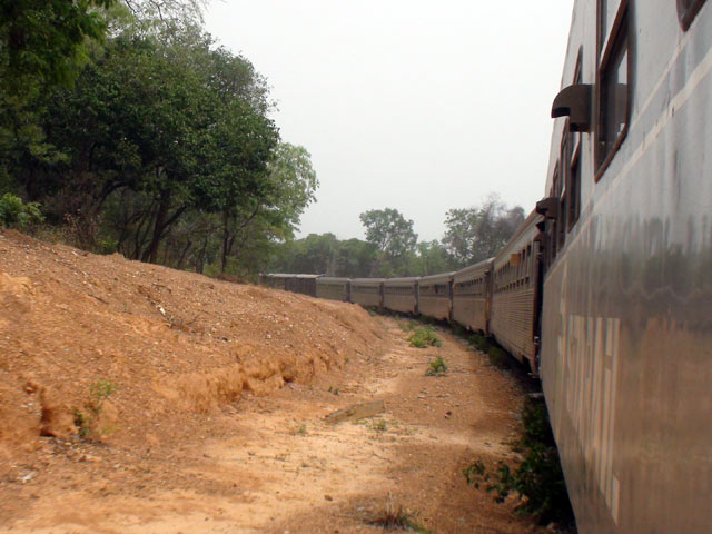 The train travels slowly through the countryside