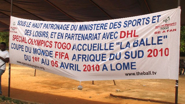 Special Olympics banner welcomes The Ball to Togo