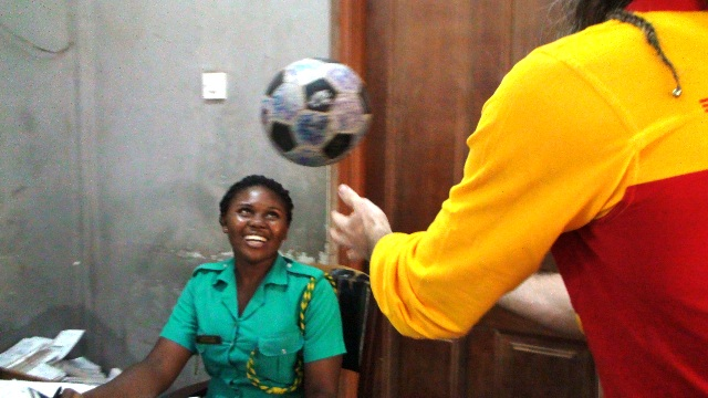 Ghanaian customer officer heads and then stamps The Ball
