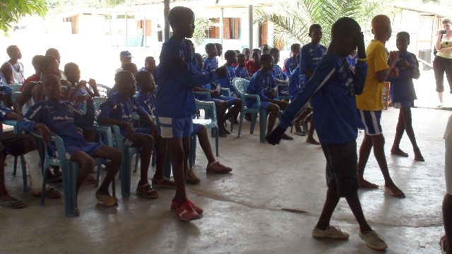 Kids from the NGO Ange perform a dance