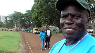 Peter Wanderi waits for the parade