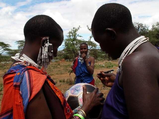 Maasai women sign The Ball