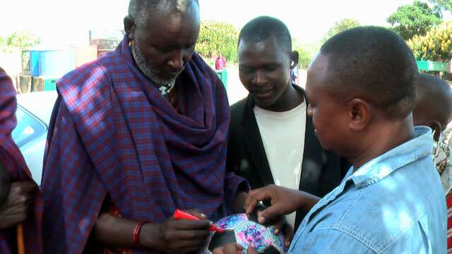 Alliy (right) introduces The Ball to a Maasai