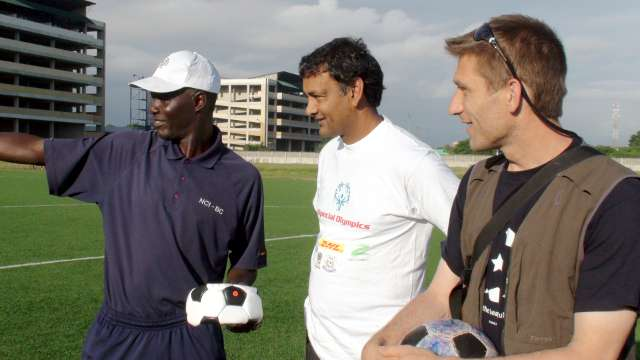 Blaise (centre) watches a football training session at the TFF