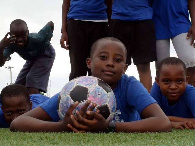 A player is proud to hold The Ball