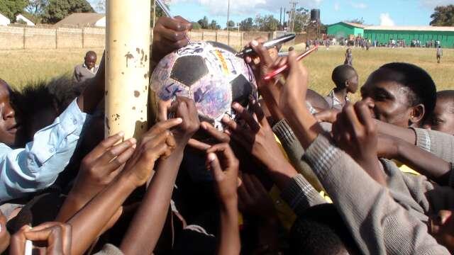 Mass signing of The Ball at Lusaka school