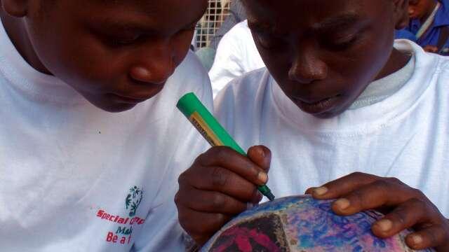 Special Olympians Mikakh Chikanga and Balire Kudzala sign The Ball