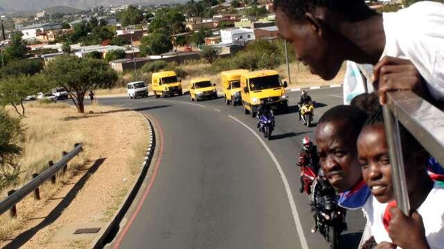 DHL vehicles follow the bus through Windhoek