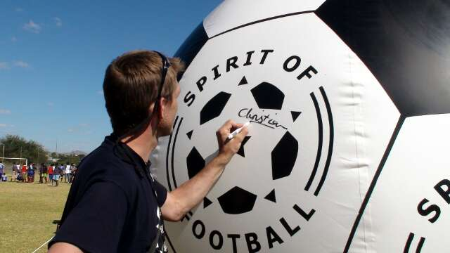 Christian signs a giant replica of The Ball