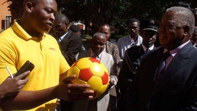 Elijah presents the President with a DHL replica of The Ball