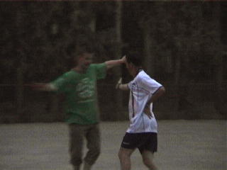 Gersh and Phil perform the traditional Uyghur goal celebration