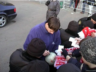 A Spartak player signs the ball