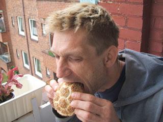 Christian eats a ball of bread