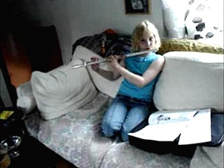 Izzy plays the flute for England
