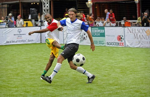 Andrew Aris looks on with consternation as Lucas Radebe fires The Ball past him