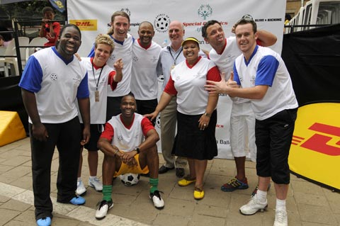 Mrs Zuma with Tom Plummer, Managing Director of DHL South Africa after the match with celebrity players from left, Bongani Nxumalo, Janine Van Wyk, Andrew Aris, Shaun Bartlett, Mark Fish, Darren Simpson and Lucas Radebe seated.